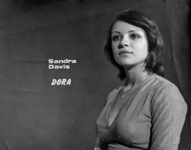 Sandra Davis - A very young Sandra Davis in character as Dora – a character written by Lino Grech, an as yet unparalleled figure in the local stage and drama scene. This photograph was, in fact, taken to promote F'Baħar Wieħed, the first Maltese soap opera to air on local stations back in the 1970s. It boasted an impressive cast of veteran stage actors of the time such as Lino himself, Gemma Portelli, Ines Farrugia, Josephine Zammit Cordina, Jane Marshall and Carmen Azzopardi amongst others. This photo was brought along by Ms.Davis herself for a filmed interview myself and my friend and frequent collaborator Jonathan Camilleri conducted with her about her recollections from the F'Baħar Wieħed days. It struck me as an exceptional portrait. Not only does the photo represent the character Dora, which as I could gather was its true purpose, it does an equally good job depicting Sandra, an immensely graceful woman threading her first decisive steps into public consciousness. And still going strong today.