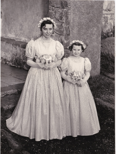 The Flower Girls. Or Happy For Her - 1959 If there is something that radiates through the many years that have gone between when this Picture was taken and today, its the two girls' pride. They're proud of the bride, proud of the roles they landed themselves in this big day. Of course, the older girl's smile is a little bit more tired…a little bit wiser. Her younger friend can't help but beam from ear to ear. Perhaps it was her big day after all.